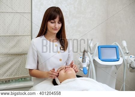 Beautiful Cosmetician Giving A Facial Lifting Massage