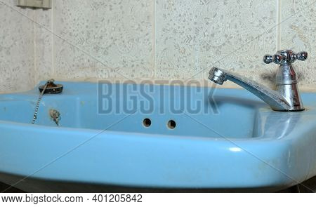 Old And Dirty Basin In The Bathroom. Basin With Faucet Use For Wash Face, Hand Or Something That Not