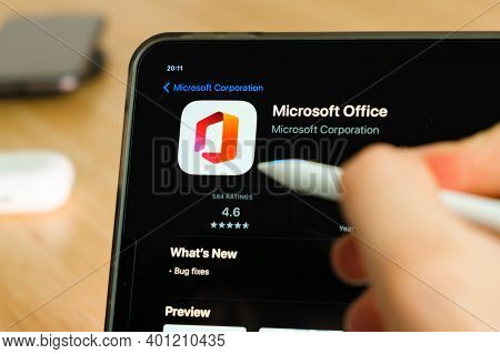 Microsoft Office Logo Shown By Apple Pencil On The Ipad Pro Tablet Screen. Man Using Application On