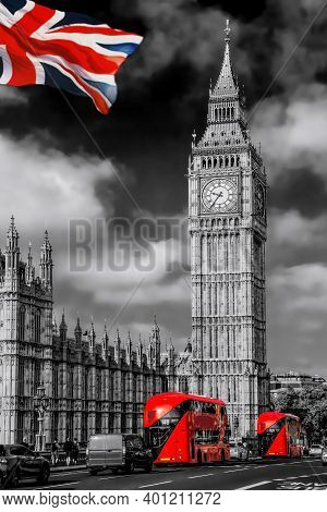 Big Ben With Red Buses On The Bridge Against Flag Of England In London, England, Uk