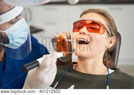 Young Confident Male Dentist Doing Medical Treatment
