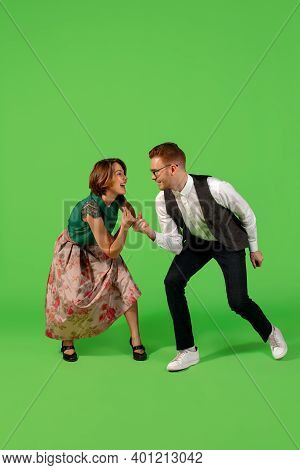 Party. Old-school Fashioned Young Woman Dancing Isolated On Green Studio Background. Artist Fashion,