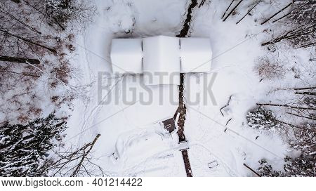 Aerial View Of Rural House Covered With Snow. Winter Icy Landscape, Fresh Stream,trees From Above.wi