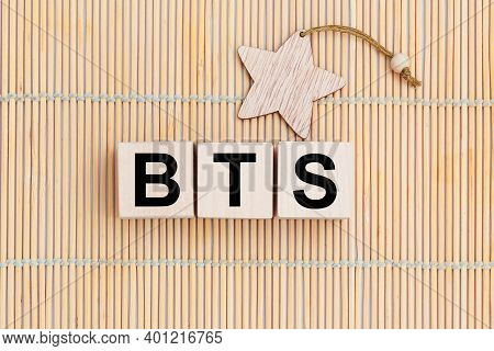 Wooden Cubes With The Abbreviation Bts On Wooden Background