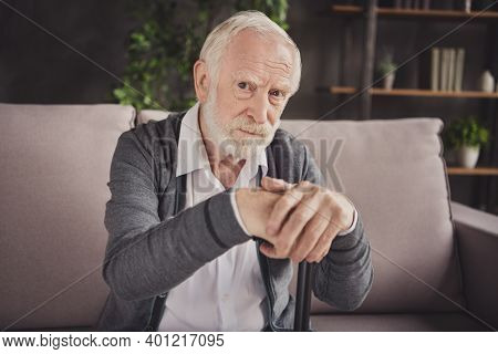 Photo Of Old Sad Depressed Man Dressed White Shirt Sitting Sofa Hands Arms Walking Cane Indoors Flat