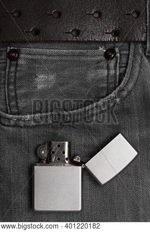 Lighter. Jeans Close-up, Texture Of Black Jeans. Jeans Pocket Close-up.