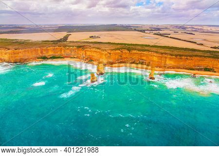 Aerial view. Great Ocean Road. The Twelve Apostles are a group of limestone rocks in the Pacific Ocean near the coast. Helicopter flight over the scenic Pacific coastline. Australia.