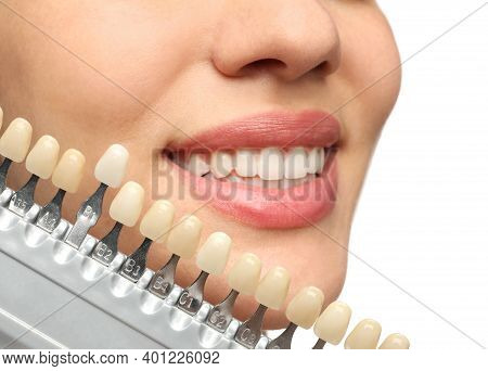 Woman Checking Her Teeth Color On White Background, Closeup. Cosmetic Dentistry