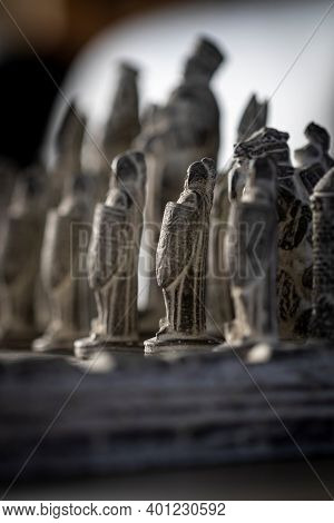 A Portrait Of A Stone Soldier In A Game Of Chess. The Soldier Acts Like A Pawn On The Chessboard And