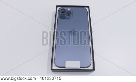 Moscow, Russia-november, 2020: New Iphone Model In Box. Action. Latest Iphone Model With Stylish Cas