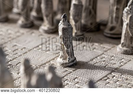A Portrait Of A Stone Soldier As A Pawn On A Chessboard. The Chess Game Is About To Start. The Strat
