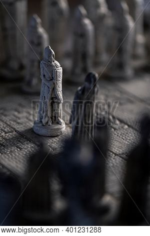 A Vertical Portrait Of The Beginning Of A Strategic Game Of Chess. The Duel Will Be Fought On A Ston