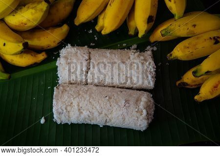 Popular Steamed Kerala Breakfast Dish Served In Banana Leaf With Yellow Banana, Puttu And Yellow Sma