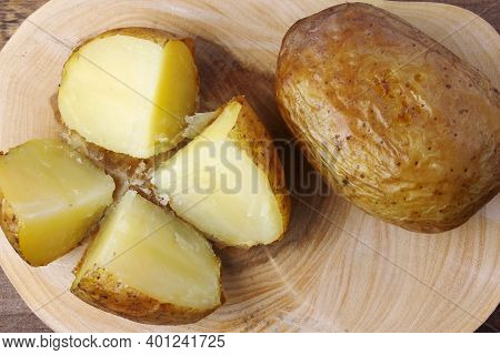 Hot Baked Potato On Rustic Wooden Table. Top View