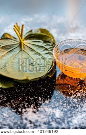 Face Mask For Controlling Oiliness Consisting Of Betel Leaves, Honey, Sea-salt On A Black Wooden Sur