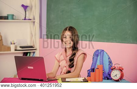 Small Girl Pupil With Computer. Use New Technology. Study Online. Lesson Alarm. Back To School. Onli