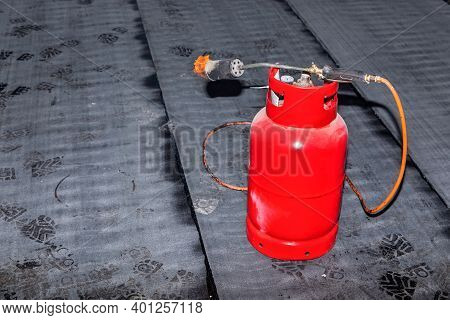 Gas Burner On The Construction Of A Family House. Asphalt Floor Insulation. Construction Site. Propa