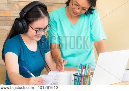 Happy Two Asian Woman Mother Is A Teacher Advice Instruction To Her Daughter Teenage Girl Student On