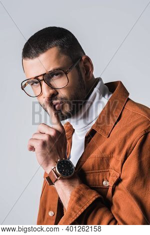Stylish Man In Eyeglasses Showing Shh Gesture At Camera Isolated On Grey