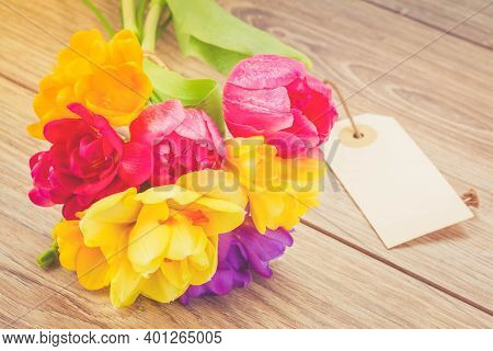 Bouquet Of Pink Tulips, Yellow Daffodils And Freesea Flowers With Empty Tag, Toned