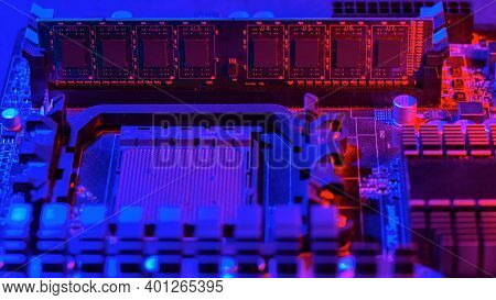 Random Access Memory Strip Inserted Into The Motherboard. Motherboard Out-of-the-box Red-blue Light.