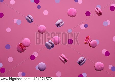 Levitation Of Macaroons, Creative Food Concept. Bold Vibrant Pink, Beige And Magenta Colors. Flying