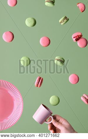 Levitation Of Macaroons, Creative Food Concept. Flying Macaroons, Plate, Hand With Espresso Coffee C