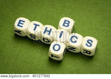 bioethics crossword in dice letters against green handmade paper, ethics, medical, biological and biotechnology research concept