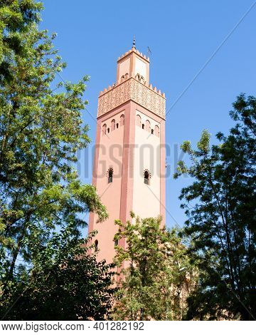 Minaret Of A Mosque Of Turkey At Marrakesh, Morocco Against Blue Sky Background