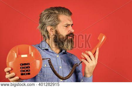 Man With Moustache Holding Vintage Phone. Vintage Communication Device. Businessman Talking On Vinta