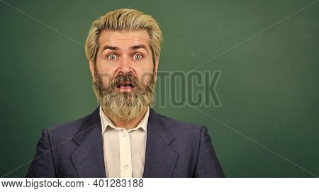 Teaching For Surprise. Surprised Teacher At Green Chalkboard. Bearded Man Keep Mouth Opened Of Surpr