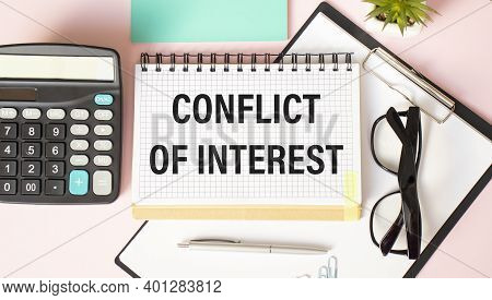 Conflict Of Interest Memo Written On A Notebook With Pen