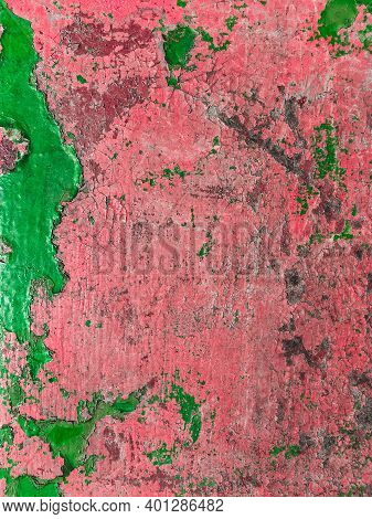 Grungy Urban Background With Red And Green Peeling Paint.