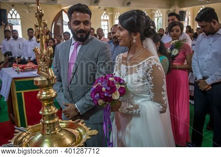 Kerala, India, 08-12-2017. Bride And Groom Closer To The Altar. Catholic Wedding In The Province Of