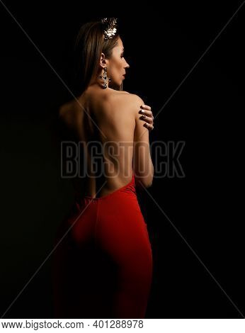 Naked Back And Profile Of Woman In Red Maxi Dress With Jewelry On Head Standing And Showing Perfect