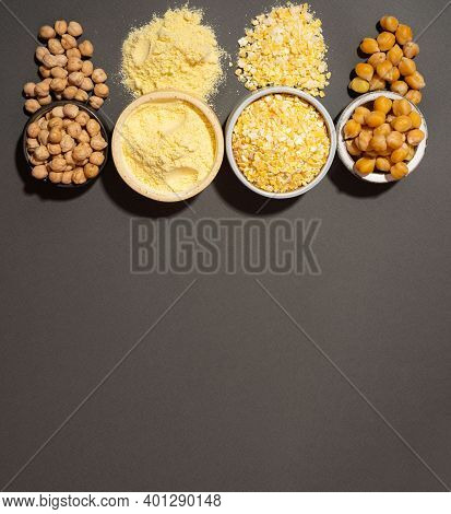 Raw And Cooked Chickpeas, Chickpea Flour And Flakes In Small Ceramic Plates, Banner Copyspace Black