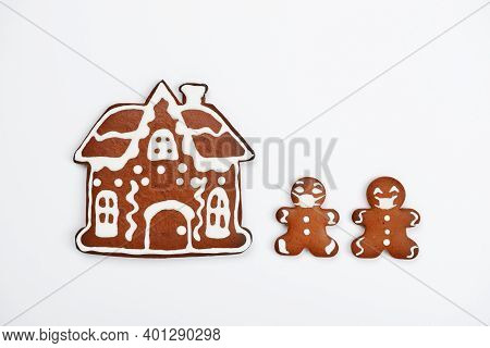 The Hand-made Eatable Gingerbread House, Little Men With Face Masks On White Background