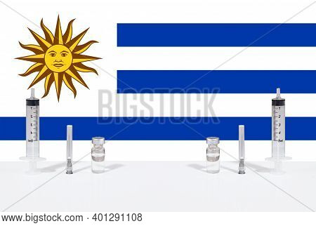 Flag Of Uruguay Illustrating Campaign For Global Vaccination Against Covid-19. Epidemic Virus