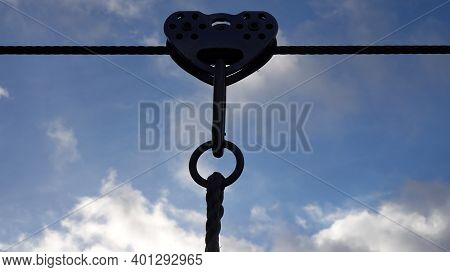 Silhouette Tow Pulley On Steel Rope, Blue Sky With White Clouds