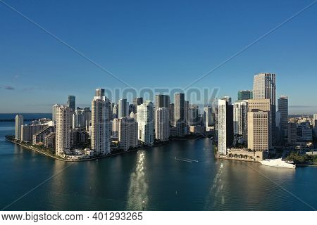 Miami, Florida - December 27, 2020 - Aerial View Of City Of Miami And Entrance To Miami River On Sun