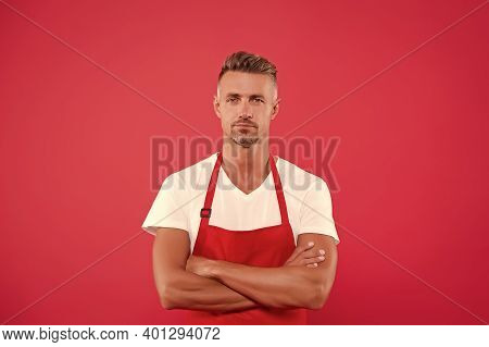 Mature Man In Apron Crossed Hands. Hostess Of The Restaurant. Fast Food Restaurant. Restaurant Staff