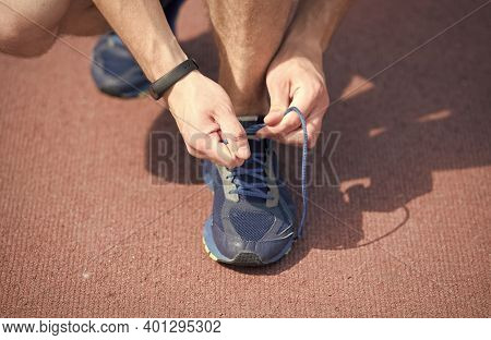 In Pursuit Of Good Health. Male Hands Lace Sport Shoe. Athletic Shoe On Arena Ground. Gym Shoe. Tyin