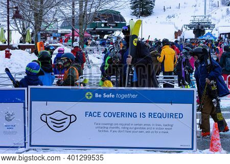 Whistler, British Columbia, Canada - December 28, 2020: Busy Line Up Of People Waiting For Gondola T