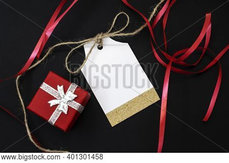 Sale Tag On Black Background Among Red Ribbon And Red Gift Box. Price Tag Gift Tag Sale Tag Address