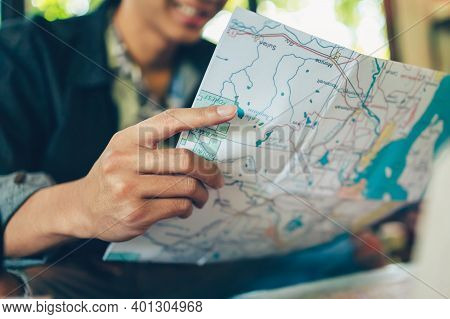 Close-up Tourist Hold Map And Planning And Reservation. Travel, Holiday, Vocation Concept.