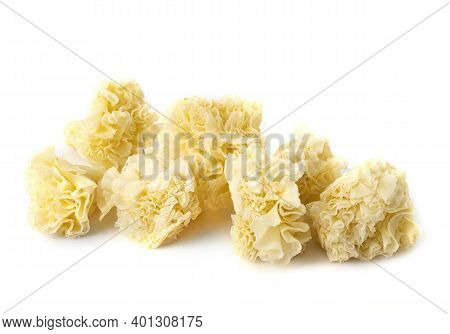 Swiss Cheese Tete De Moine In Front Of White Background