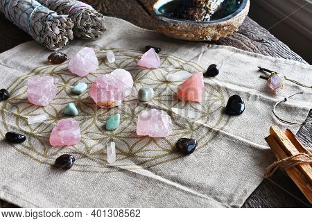 A Close Up Image Of A Self Love And Self Healing Crystal Grid Using Sacred Geometry And Rose Quartz