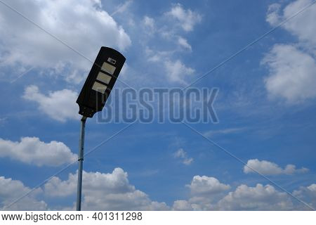 Close Up Isolated Led Lamppost With Bright Cloudy Sky