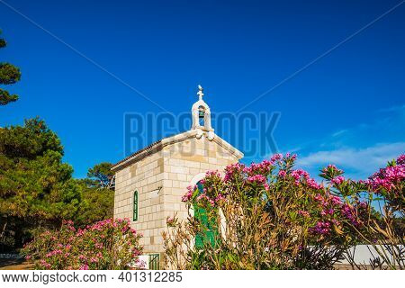 Stone Chapel On Veli Rat Among The Pines On Sunny Day, Mediterranean Landscape, Island Of Dugi Otok,