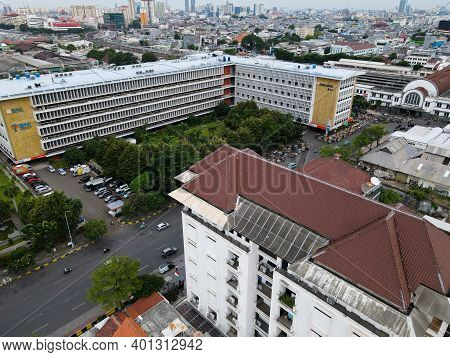 Aerial View Of Jakarta Kota Train Station With Jakarta Cityscape Background. Jakarta, Indonesia - De